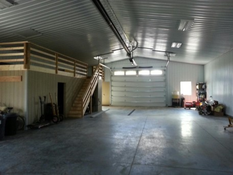 Interior Storage solution for agricultural buildings. Showcases office, interior above office storage and workshop space options.