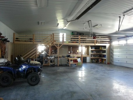 Interior Storage solution for agricultural buildings. Showcases office area, interior above loft storage and workshop space options. Clean Astro wall options, large overhead door.