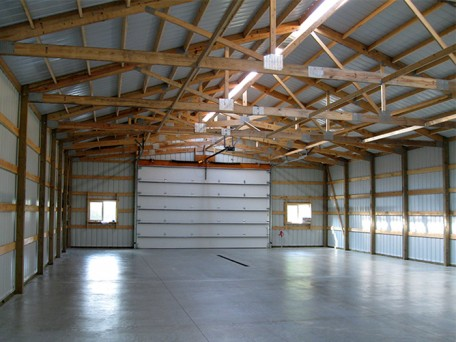 Pristine Finished Interior of a Pole Building/Agricultural/Garage/Shop showing garage bay for flexibility in building use. <strong>Utilizes Scissor Trusses for extended interior height. Ridge Lighting. </strong>