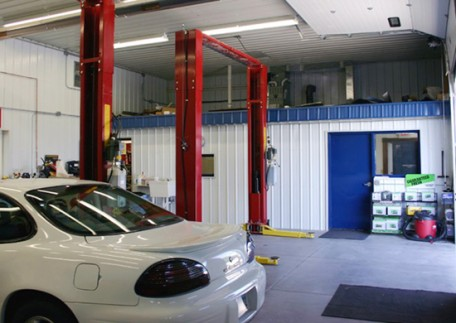 Eco-friendly cost effective solutions for your commercial building or automobile garage. Interior of an automobile repair shop.